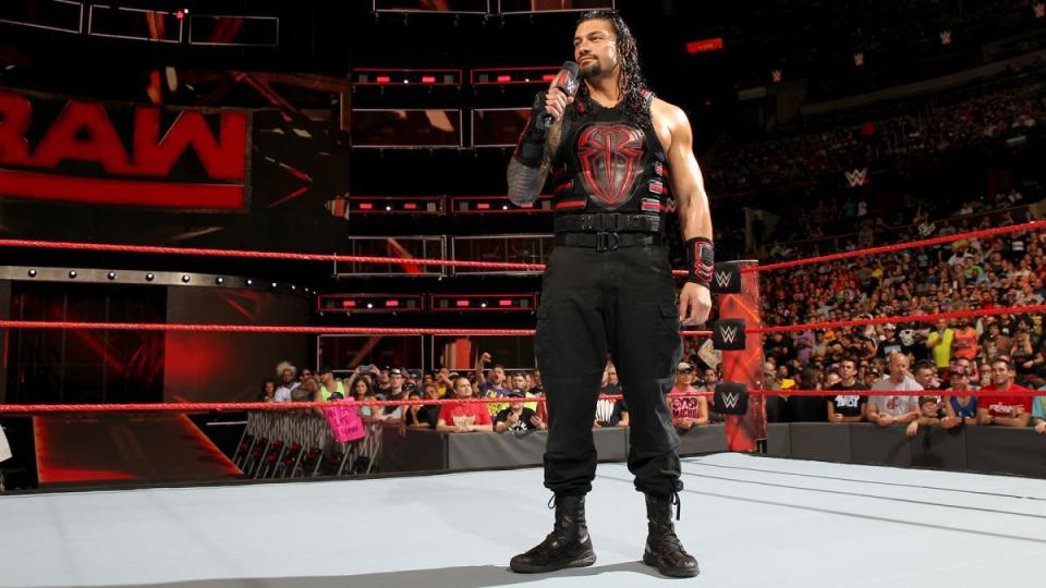 roman-reigns-stands-waiting-while-the-fans-boo-him.jpg